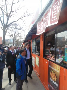 Federal Liberal leader Justin Trudeau inspects the innovative Market 707 at Scadding Court Community Centre on April 23rd. The market allows start-ups to set up shop right on the sidewalk from within converted shipping containers.