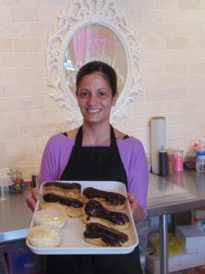 Sugary Swirl's owner Sonia Esteves displays just a very small sample of the rich variety of her baked goods crafted exclusively on site. The shop is located just south of Dupont on the east side of Bathurst Street.