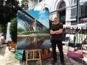 Ashley James Thomas of The Art House Gallery, 594 Markham St. participated in the The Mirvish Village Sidewalk Sale on Markham Street Saturday & Sunday, September 20-21 with, among others, this painting of the Bloor Street Viaduct. COURTESY LAURA BURNHAM, MIRVISH VILLAGE BIA
