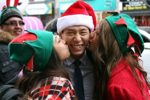 On Nov. 16, the Santa Claus parade came along Bloor Street. The Bloor Annex BIA reprised its popular kissing stations with mistletoe hanging from some of the BIA's lights on the streets. Some were more lucky under the lights than others.