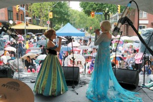 Anna and Elsa, characters from Frozen, perform their show Snow Queen at the well-attended 19th Annual Annex Family Festival on June 14. The one-day Bloor Street festival was  organized by the Miles Nadal Bloor Jewish Community Centre and sponsored by the Bloor Annex BIA. Photo by Mircea, courtesy of the MNBJCC