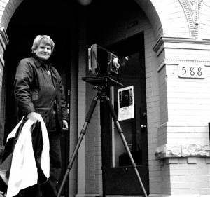 Gerald Pisarzowski, poses in front of Charlotte Hale & Associates Gallery on Markham St. Photo Courtesy of Charlotte Hale