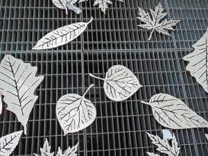 Steel leaves welded onto the Toronto Transit Commission venting grills at Matt Cohen Park add to the park's theme of balancing nature and urban living.