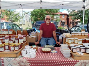 """You have to touch and smell the goods to appreciate them,"" says Doug Eiche, beekeeper and honey farmer, pictured above at the Bloor-Borden Farmers' Market."