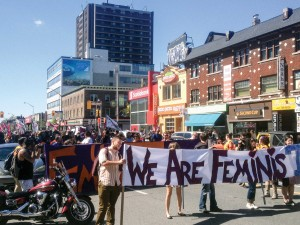 Hundreds of University of Toronto students, faculty, and staff take to Bloor Street just east of Spadina Avenue on Sept. 14 after the university announced that online threats had been made against feminists. Brian Burchell/Gleaner News