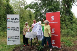 Pam McConnell (Ward 28, Toronto Centre-Rosedale), Christopher Hayes of Scotiabank, poet laureate George Elliott Clarke, and Heritage Toronto board member Kate Marshall unveil a plaque on Ward's Island commemorating poets Gwendolyn MacEwen and Milton Acorn. COURTESY?HERITAGE?TORONTO