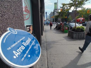 "This Toronto Legacy Plaque on Bloor Street honours Anna Russell, the ""funniest woman on the opera stage"", says Grace Westcott, chair of the Toronto Legacy Project. The group has been nominated for a 2015 Heritage Toronto Award, one of several Annex-related nominees this year. Brian Burchell, Gleaner News"