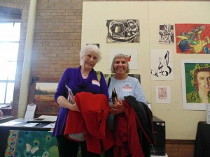Alberta Nye (left) and friend Rose Kita, both class of 1958, staff the auction table. The alumni were raising money for the school and its activities.