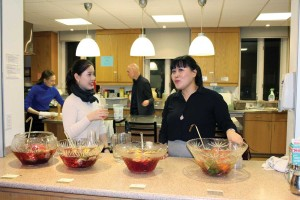 St. Thomas's Anglican Church parishioner Tina J. Park (right) and friend Sowon Kim serve three flavours of fruit punch during a parish hall reception following the church's Voices of Refuge fundraising concert. Photo courtesy Julia Armstrong