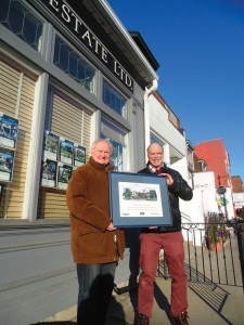 Neil Wright, chair, and Joe Caversham, treasurer, both of the Harbord Street Business Improvement Area (BIA), pose with a graffiti prevention award, presented to the BIA by the Toronto Association of Business Improvement Areas for its work in improving the streetscape. Brian Burchell, Gleaner News