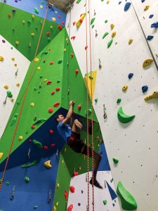 MICHAEL CHACHURA/GLEANER NEWS Tomek Iwanek takes on an intermediate course rated 5.9 at the newly opened Basecamp Climbing (677 Bloor St. W.) in the former Metro Theatre.