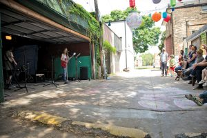 PHOTOS COURTESY OF KYM WATTS: Laneways, porches, and garages come alive with music during Seaton Village's Open Tuning festival. Musicians of all ages, genres, and abilities are welcome to perform during this community celebration, which is modelled on La Fête de la Musique in Paris.