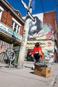 PHOTO BY GEREMY BORDONARO: A Mona Lisa mural surveys the scene on Kensington Avenue. The market is undergoing a study to determine whether it should become a Heritage Conservation District.