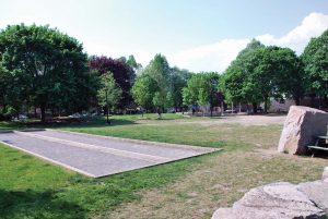 PHOTO BY EMILY REA/GLEANER NEWS: Vermont Square, with its pirate playground, bocce ball courts, and ample space, is one of the best we reviewed this month despite the sandy areas where the grass has been worn down.
