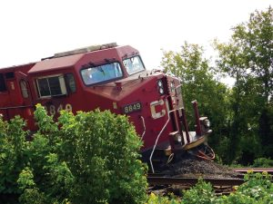 PHOTO COURTESY ARLYN MCADOREY: A Canadian Pacific Railway locomotive derailed near Howland Avenue and Dupont Street on Aug. 21 after two of its freight trains collided, the cause of which remains unknown. Posting on Twitter shortly after the derailment, Transport Canada said that its rail and dangerous goods specialists were on site, and that a minister's observer had examined the scene. The Transportation Safety Board of Canada has also announced that the derailment is under investigation. The Gleaner will follow up in the September edition.
