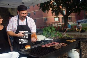 PHOTO BY GEREMY BORDONARO: The Kensington Market Refugee Project, a private group of concerned residents working in partnership with St. Stephen-in-the-Fields, held a neighbourhood block party on Sept. 7 to help raise $50,000 to sponsor a Syrian refugee family and help them settle in Canada. The market, which is home to the city's first [road mural INSERT LINK], will also come alive with jazz, when the first Kensington Market Jazz Festival launches Sept. 16 to 18.