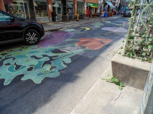 PHOTO BY SUMMER REID/GLEANER NEWS: The city's first road mural was installed late last month on Baldwin Street in Kensington Market. Part of the StreetARToronto Road Mural program, the mural is the result of a collaboration between artists and the Kensington Market BIA. The mural was painted using latex paint, which is made to withstand weather elements and foot traffic for six to nine months. The City of Toronto launched the pilot project after a proposal to legalize road murals did not pass Toronto City Council. Four additional murals will be installed throughout the city under the project by the end of October.  —Summer Reid/Gleaner News