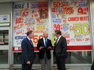PHOTO BY NOELLE?DEFOUR/GLEANER NEWS: TTC chair Josh Colle (Ward 15, Eglinton-Lawrence), David Mirvish, and Mayor John Tory mark the impending closing of Honest Ed's by unveiling a poster mimicking the discount store's signature advertising style at the Bathurst Street entrance of Bathurst Station on Nov. 1. The store will officially close on Dec. 31.